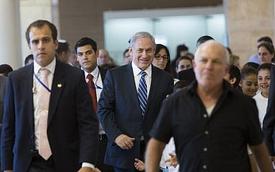 Prime Minister Benjamin Netanyahu (center) in the Israeli parliament, November 10, 2014. (photo credit: Yonatan Sindel/Flash90)