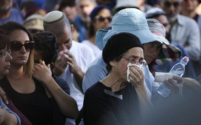 Friends and family seen mourning during the funeral ceremony of Dalia Lemkus at the Jewish settlement of Tekoa in the West Bank on November 11, 2014. (photo credit: Hadas Parush/Flash90)