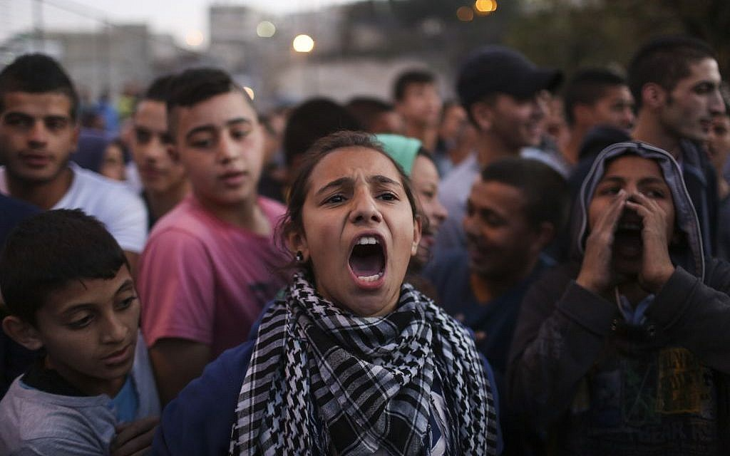 Palestinians protest in Issawiya, East Jerusalem, against the introduction of cement blockades at the entrance to the village following a terror attack in West Jerusalem, November 12, 2014. (photo credit: Hadas Parush/Flash90)