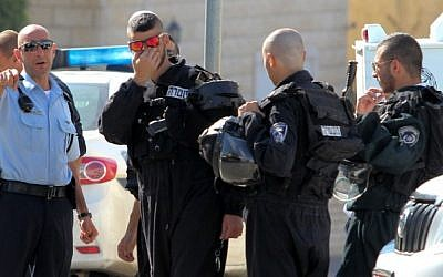 Police at the site where a large fight broke out between local Muslim and Druze residents in the Abu Snan village in northern Israel, November 15, 2014. (photo credit: Flash90)