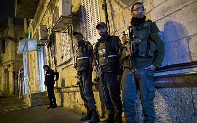 Border Police at the scene of the stabbing on Hanevi'im Street in Jerusalem, November 16, 2014. (photo credit: Yonatan Sindel/Flash90)
