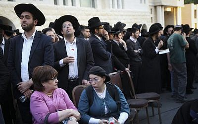 Hundreds attend the funeral ceremony of three out of the four victims who were murdered by two Palestinians at a synagogue in the Ultra-Orthodox Har Nof neighborhood in Jerusalem on November 18, 2014. (photo credit: Hadas Parush/Flash90)