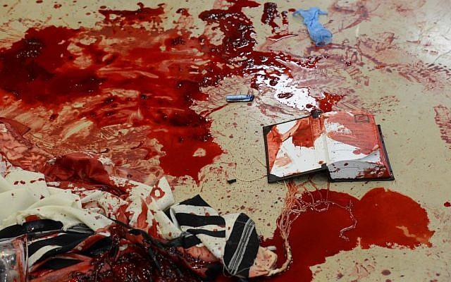 Blood on prayer shawls and prayer books inside Har Nof's Kehilat Yaakov synagogue, where two Palestinian terrorists attacked worshipers at prayer, killing four, on November 18, 2014. (Photo credit: Kobi Gideon/GPO/FLASH90)