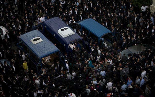 Thousands attend the funeral of three of the four victims killed in an attack on a synagogue in Har Nof, Jerusalem, November 18, 2014 (photo credit: Miriam Alster/Flash90)