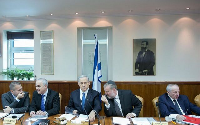 From left to right: Interior Minister Gilad Erdan, Intelligence Minister Yuval Steinitz, Prime Minister Benjamin Netanyahu, cabinet secretary Avichai Mandelblit and Attorney General Yehuda Weinstein at the weekly cabinet meeting in Netanyahu's office in Jerusalem, November 23, 2014. (photo credit: Ohad Zweigenberg/Pool/Flash90)