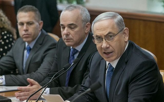 Prime Minister Benjamin Netanyahu (right), with ministers Gilad Erdan (left) and Yuval Steinitz (center), during a cabinet meeting in Jerusalem, November 23, 2014 (Ohad Zwigenberg/Flash90/Pool)