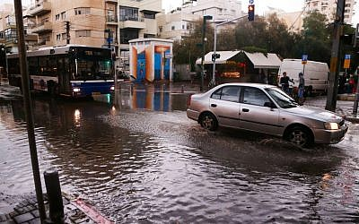 Cars drive in the rain in Tel Aviv on November 25, 2014. (photo credit: Flash90)