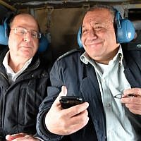 Defense Minister Moshe Ya'alon (left), and then-Maj. Gen. Gadi Eisenkot when Eisenkot learned he had won the appointment to head the Israel Defense Forces, November 27, 2014. (Ariel Hermoni/Ministry of Defense)