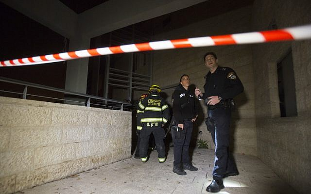 Firefighters and police at the scene of where suspected arsonists set fire to a bilingual Hebrew-Arabic school in Jerusalem, November 29, 21014. (photo credit: Yonatan Sindel/Flash90)