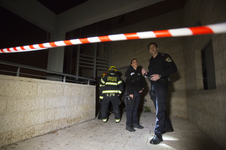 Firefighters and police at the scene of where suspected arsonists set fire to a bilingual Hebrew-Arabic school in Jerusalem. (photo credit: Yonatan Sindel/Flash90)