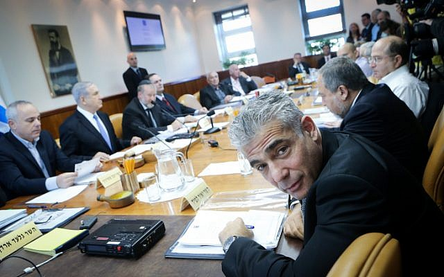Finance Minister Yair Lapid attends the weekly cabinet meeting at his office in Jerusalem on November 30, 2014. (photo credit: Alex Kolomoisky/POOL/FLASH90)