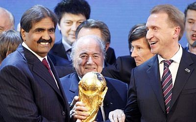 FIFA President Joseph Blatter as he is is flanked by Russian Deputy Prime Minister Igor Shuvalov right, and Sheikh Hamad bin Khalifa Al-Thani, Emir of Qatar left, after the announcement December 2, 2010, that Russia and Qatar will host the soccer World Cup tournaments in 2018  and 2022 respectively. (photo credit: AP/Michael Probst, File)