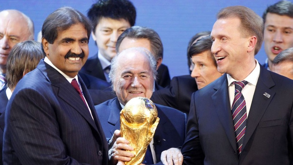 FIFA President Joseph Blatter as he is is flanked by Russian Deputy Prime Minister Igor Shuvalov (R), and Sheikh Hamad bin Khalifa Al-Thani, Emir of Qatar (L), after the announcement December 2, 2010, that Russia and Qatar will host the soccer World Cup tournaments in 2018  and 2022 respectively. (photo credit: AP/Michael Probst, File)