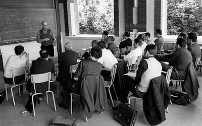 This photo provided Friday, Nov.14, 2014 by the IHES (High Scientific Studies Institute) shows mathematician Alexandre Grothendieck, at the blackboard, during a lesson, south of Paris, in the 1960's. (photo credit: AP Photo/IHES)
