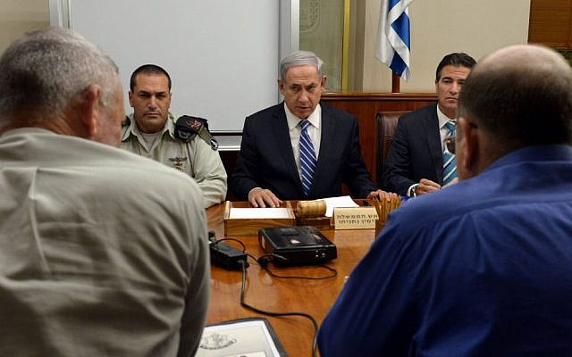 Benjamin Netanyahu, center, meeting with security officials in Jerusalem on November 10, 2014. (photo credit: Haim Zach/GPO)