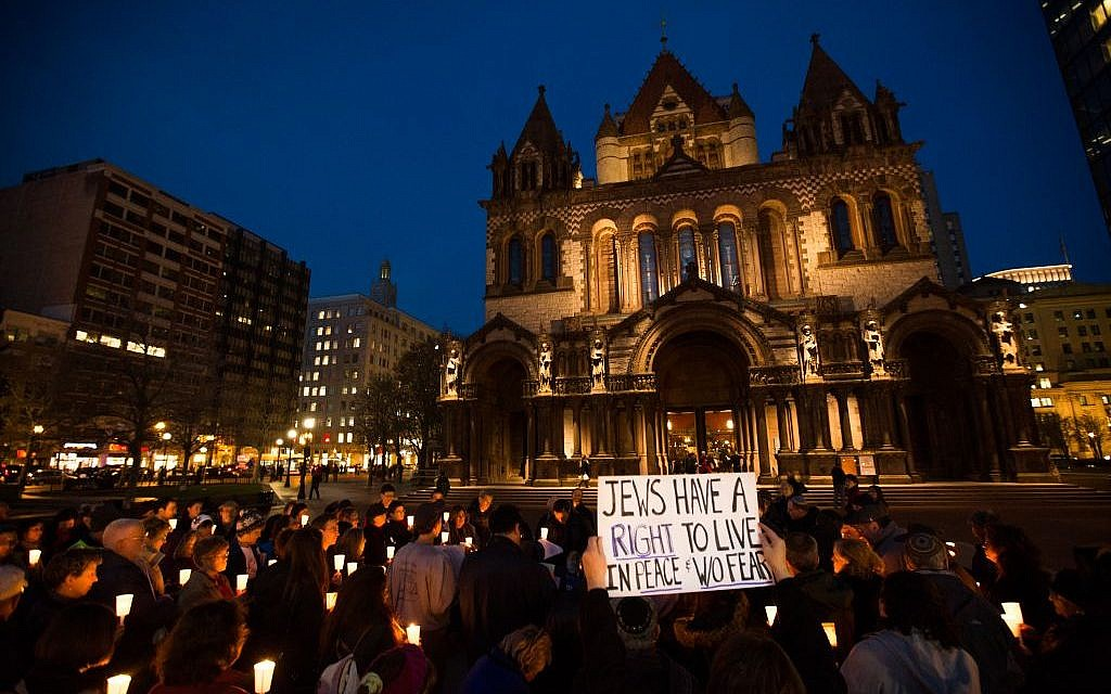 More than 150 Boston-area Jews gathered in front of the city's Trinity Church yesterday for a vigil to remember the victims of last week's Jerusalem synagogue terror attack (photo credit: Elan Kawesch/The Times of Israel)