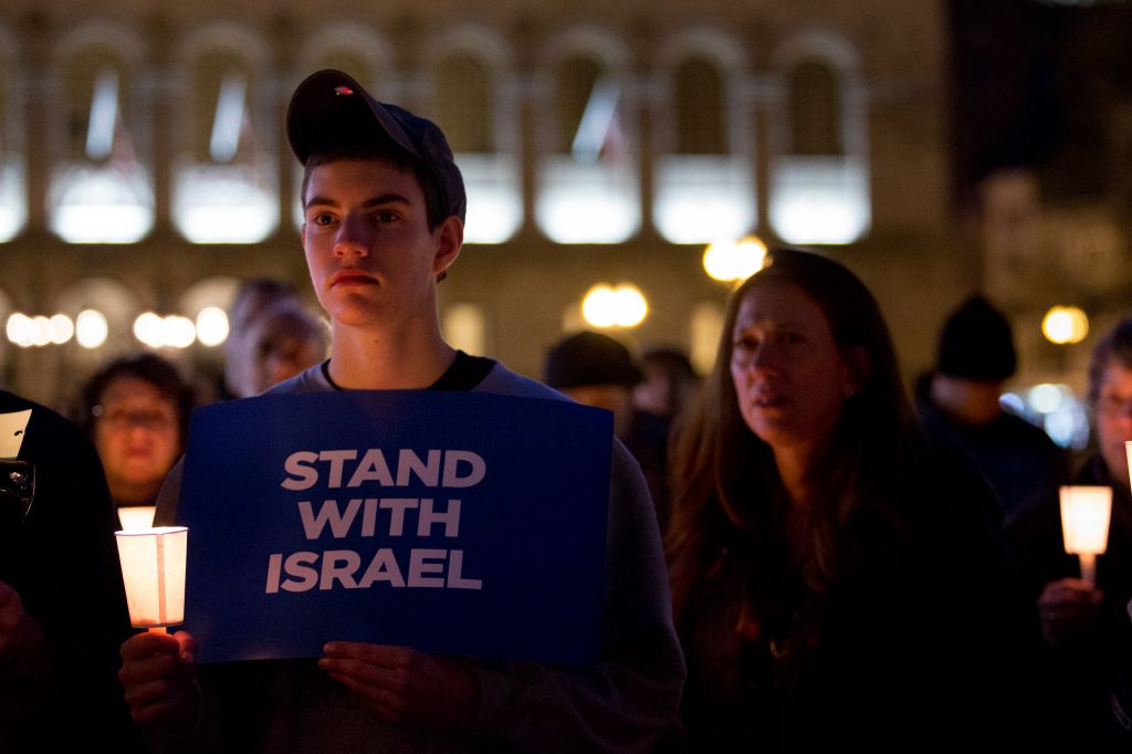 Seventeen-year-old Andrew Jacobson of Swampscott, Massachusetts, attended a memorial service yesterday in Boston for the victims of last week's Jerusalem synagogue terror attack (photo credit: Elan Kawesch/The Times of Israel)