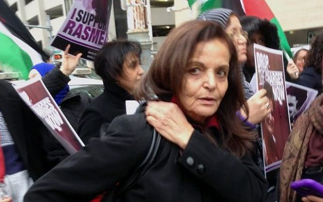 Rasmieh Odeh stands with supporters outside the federal courthouse in Detroit on Tuesday, Nov. 4, 2014 Odeh, associate director at Chicago's Arab American Action Network, is charged with failing to tell US immigration about her conviction for bombings in Israel in 1969 that killed two people at a supermarket. (Photo credit: AP/Ed White)