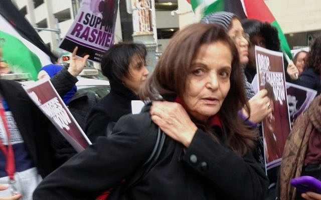 Rasmieh Odeh stands with supporters outside the federal courthouse in Detroit, November 4, 2014. (AP/Ed White)
