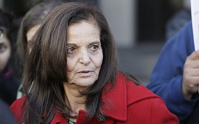 In this Monday, Nov. 10, 2014, file photo, Rasmieh Yousef Odeh, 67, of Chicago is interviewed outside federal court in Detroit, after the Palestinian immigrant was found guilty of immigration fraud for failing to disclose her conviction and imprisonment in a Jerusalem supermarket bombing that killed two people. (AP/Carlos Osorio)
