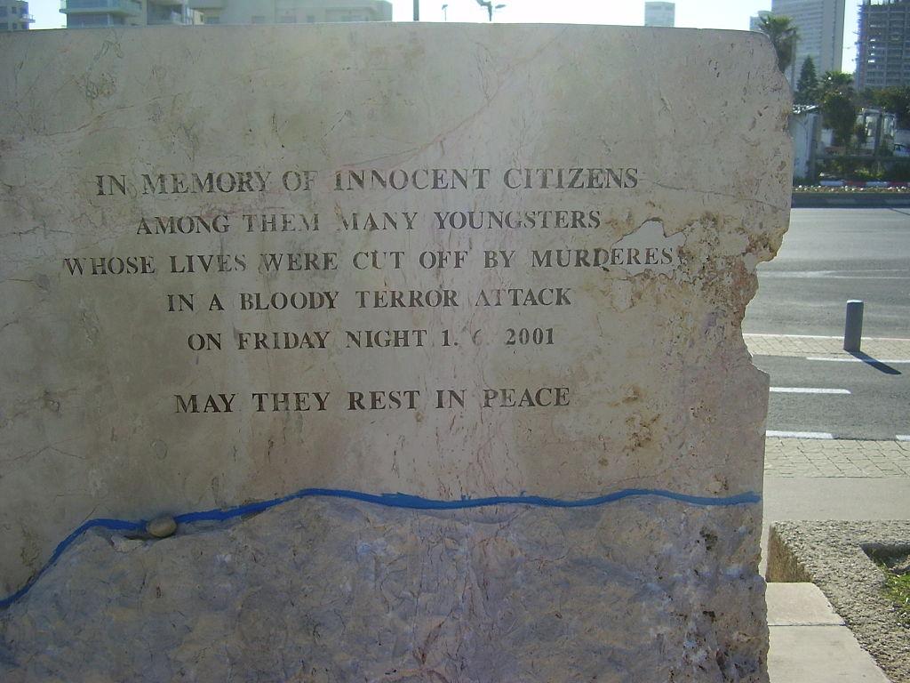 Inscription on the Dolphinarium Massacre memorial (photo credit: Avi1111 dr. avishai teicher /Wikipedia)