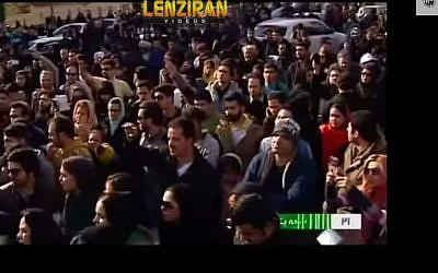 Crowds attending the funeral of Iranian pop singer Morteza Pashaei who died November 2014. (screen capture: YouTube/Manuchehr Lenziran)