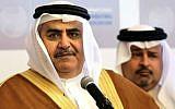 Bahraini Foreign Minister Sheik Khalid bin Ahmed al-Khalifa speaking with journalists at a conference focused on combating international terror financing in Manama, Bahrain, on November 9, 2014. (photo credit: AP/Hasan Jamali)