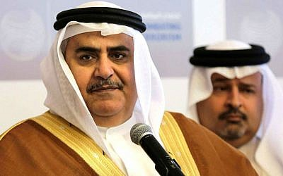 Bahraini Foreign Minister Sheik Khalid bin Ahmed al-Khalifa speaking with journalists at a conference focused on combating international terror financing in Manama, Bahrain, on November 9, 2014. (photo credit: AP/Hasan Jamali)