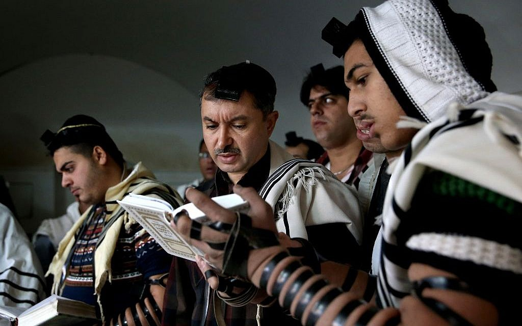 In this Thursday, Nov. 20, 2014 photo, Iranian Jewish men pray at the Molla Agha Baba Synagogue, in the city of Yazd 420 miles (676 kilometers) south of capital Tehran, Iran. (photo credit: AP Photo/Ebrahim Noroozi)