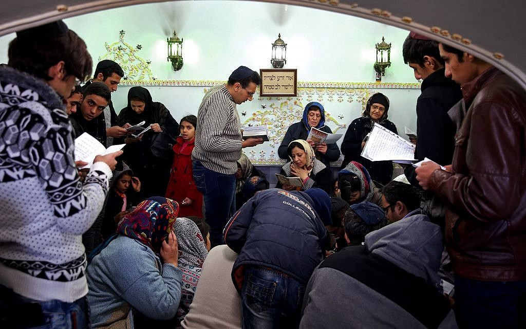Iranian Jews pray at the tomb of Harav Oursharga, one of the holiest Jewish sites in Iran, in the city of Yazd 420 miles (676 kilometers) south of capital Tehran, November 20, 2014. (AP Photo/Ebrahim Noroozi)