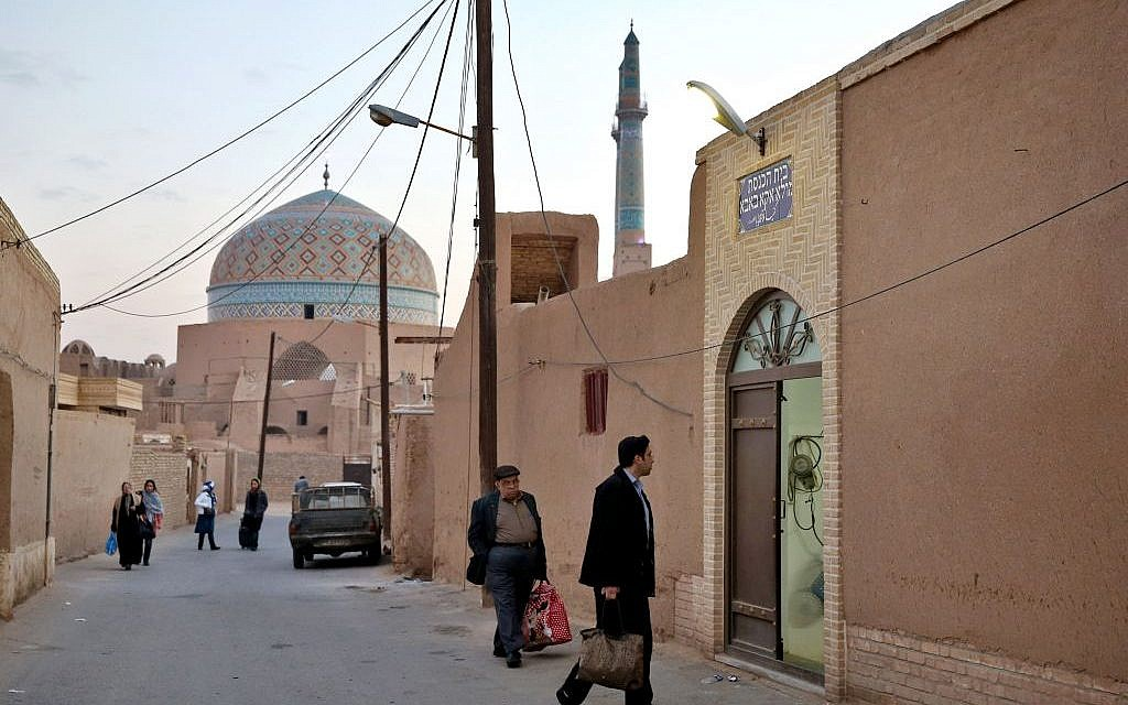 In this Thursday, Nov. 20, 2014 photo, Iranian Jews men enter the Molla Agha Baba Synagogue, in the city of Yazd 420 miles (676 kilometers) south of capital Tehran. (photo credit: AP Photo/Ebrahim Noroozi)