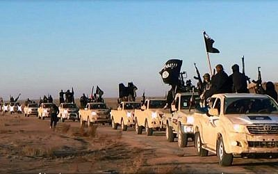 This file image posted on a militant website on Tuesday, Jan. 7, 2014, shows a convoy of vehicles and fighters from the Islamic State in Iraq's Anbar Province. (photo credit: AP Photo/militant website)