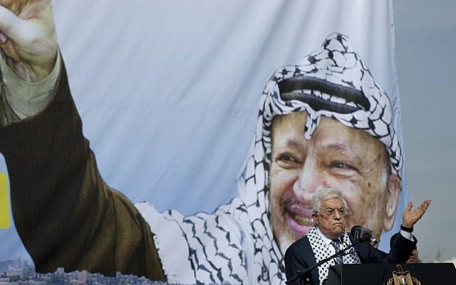 Palestinian Authority President Mahmoud Abbas addresses supporters during a ceremony marking the 10th anniversary of the Palestinian leader Yasser Arafat's death, at his headquarters in the West Bank city of Ramallah, November 11, 2014. (AP Photo/Nasser Nasser)