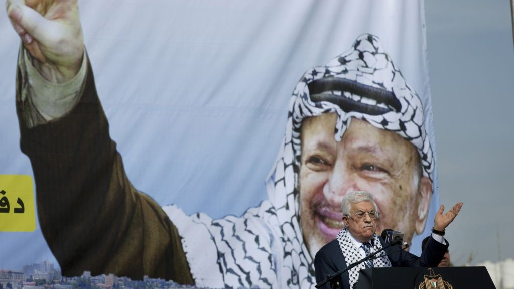 Palestinian Authority President Mahmoud Abbas addresses supporters during a ceremony marking the 10th anniversary of the Palestinian leader Yasser Arafat's death, at the his headquarters in the West Bank city of Ramallah, Tuesday, Nov. 11, 2014. (photo credit: AP Photo/Nasser Nasser)