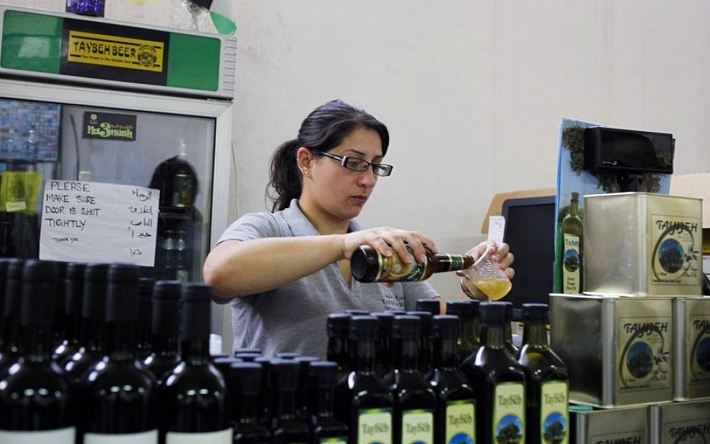 A woman works at the Palestinian Taybeh brewery in Taybeh, West Bank October 28, 2014 (Photo credit: Nasser Shiyoukhi/AP)