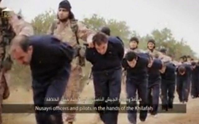 This still image taken from an undated video, published on the Internet by Islamic State terrorists on November 16, 2014, purports to show IS marching Syrian soldiers before beheading them. (photo credit: AP)