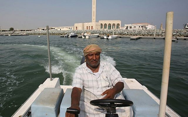 Emirati fisherman Rashid Salem Abdullah Binyim rides his boat off coast of Umm al-Quwain, United Arab Emirates. UAE's late leader Sheik Zayed bin Sultan Al Nahyan patronized tribes and villages under his leadership by establishing an expansive welfare program that younger generations of Emiratis have come to expect. This gravy train has created a vast middle class of Emiratis who almost entirely rely on the government for jobs and benefits to maintain their standard of living. Monday, July 13, 2014 (photo credit: AP/Kamran Jebreili)