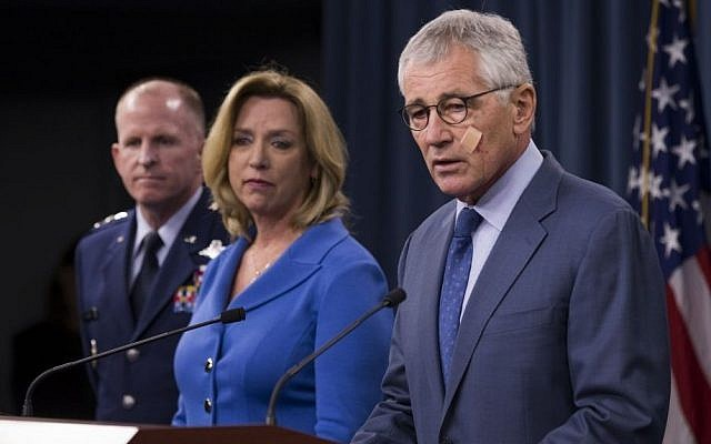 Defense Secretary Chuck Hagel speaks during a news conference at the Pentagon, Friday, Nov. 14, 2014, where he announced that he is ordering top-to-bottom changes in how the nation's nuclear arsenal is managed. From left are, Air Force Global Strike Command Commander Lt. Gen. Stephen Wilson, Air Force Secretary Deborah Lee Jones, and Hagel. (photo credit: AP/Evan Vucci)