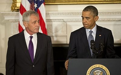 President Barack Obama, standing with Defense Secretary Chuck Hagel, talks about Hagel's resignation during an event in the State Dining Room of the White House in Washington, Monday, Nov. 24, 2014. (photo credit: AP Photo/Pablo Martinez Monsivais)