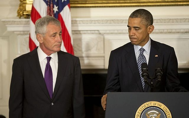 President Barack Obama, standing with Defense Secretary Chuck Hagel, talks about Hagel's resignation during an event in the State Dining Room of the White House in Washington, Monday, November 24, 2014. (photo credit: AP Photo/Pablo Martinez Monsivais)