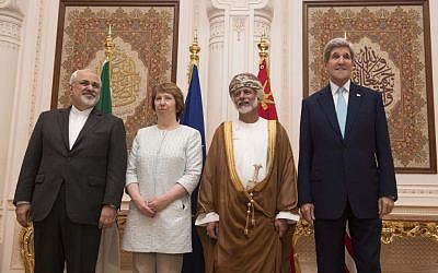 From left, Iranian Foreign Minister Javad Zarif, European Union adviser Catherine Ashton, Omani Minister Responsible for Foreign Affairs Yussef bin Alawi and US Secretary of State John Kerry, in Muscat on Sunday Nov. 9, 2014. (photo credit: AP PHOTO/NICHOLAS KAMM, POOL)