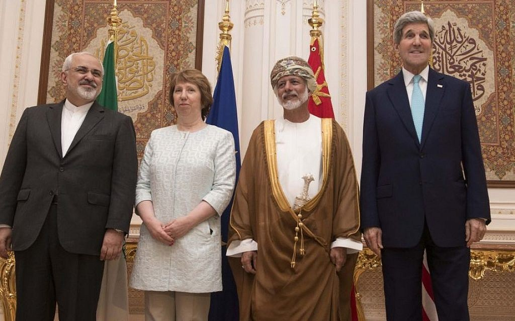 Posing for a photo are, from left, Iranian Foreign Minister Javad Zarif, European Union adviser Catherine Ashton, Omani Minister Responsible for Foreign Affairs Yussef bin Alawi and US Secretary of State John Kerry, in Muscat on Sunday Nov. 9, 2014. Talks are underway in high-level negotiations to limit Iran's nuclear program in exchange for easing crippling sanctions on the Islamic republic's economy. (photo credit: AP PHOTO/NICHOLAS KAMM, POOL)