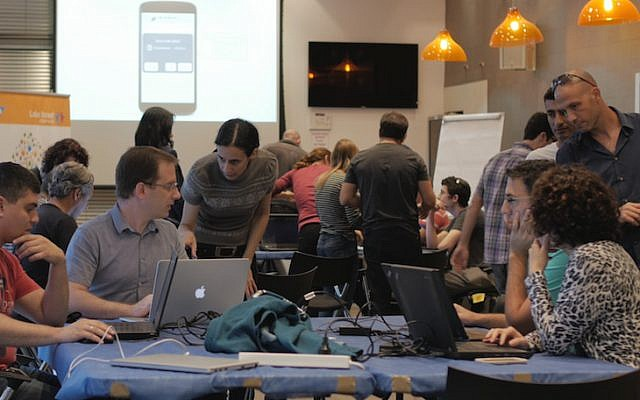 SAP volunteers work to develop the ALS data hack at the Prize4Life hackathon (Photo credit: Courtesy)