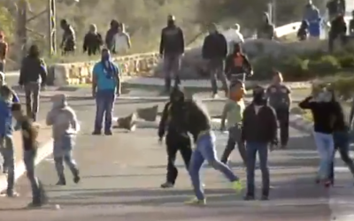Riots in Kafr Kanna on Saturday, November 8, 2014, after police shoot and kill an Arab man Friday night. (screen capture: Channel 2)
