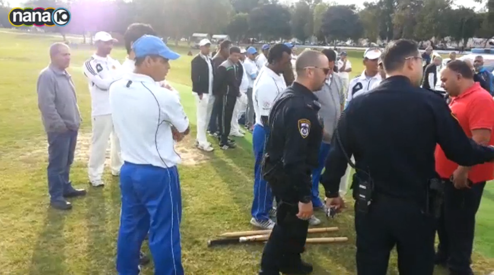 Players and police at the scene of Ashdod cricket game, in which an umpire died after he was hit by the ball, November 29, 2014 (Channel 10 screenshot)