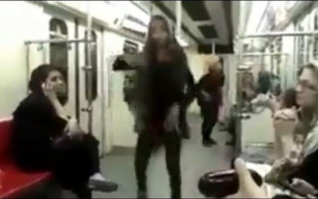 Iranian woman dances on Tehran subway, flaunting country's laws (screen capture: My Stealthy Freedom)