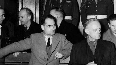 still untangling nazis legal legacy the times of nazi war criminals rudolf hess left and joachim von ribbentrop in the defendants
