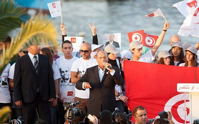 Presidential candidate and Tunisian President, Moncef Marzouki, addresses his supporters during a campaign meeting in Bizerte, northern Tunisia, Wednesday, Nov. 19, 2014 (photo credit: AP/Aimen Zine)