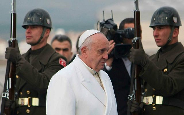 Pope Francis walks past the honor guard as he arrives at the Esenboga airport in Ankara on November 28, 2014. (photo credit: AP Photo/STR)
