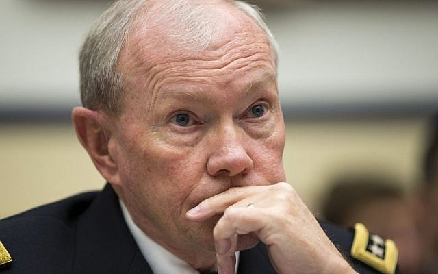 Joint Chiefs Chairman Gen. Martin Dempsey listens on Capitol Hill in Washington, Thursday, Nov. 13, 2014, while testifying before the House Armed Services committee hearing on the Islamic State group. (Photo credit: AP/Evan Vucci)